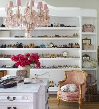 V Day - pink chandelier and chair in shoe closet