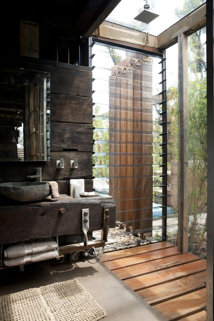 Outdoor shower with timber and louvre windows