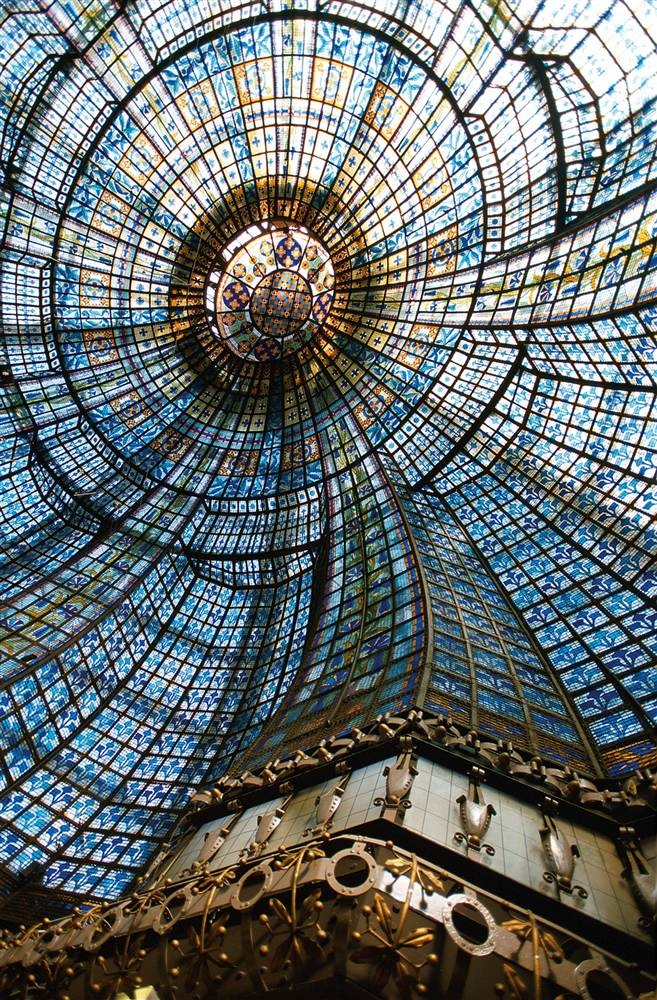 111Elaborate stained-glass cupola (dome) inside Magasins du Printemps in Paris