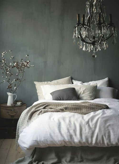 Grey bedroom with chandelier