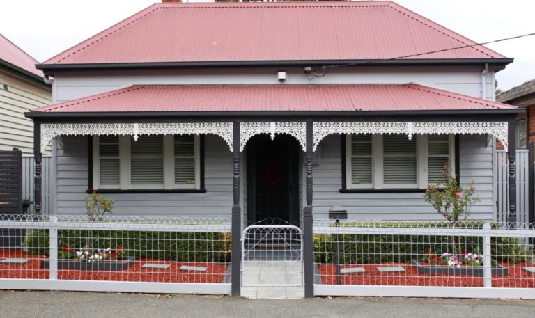 Grey & white Victorian weatherboard cottage